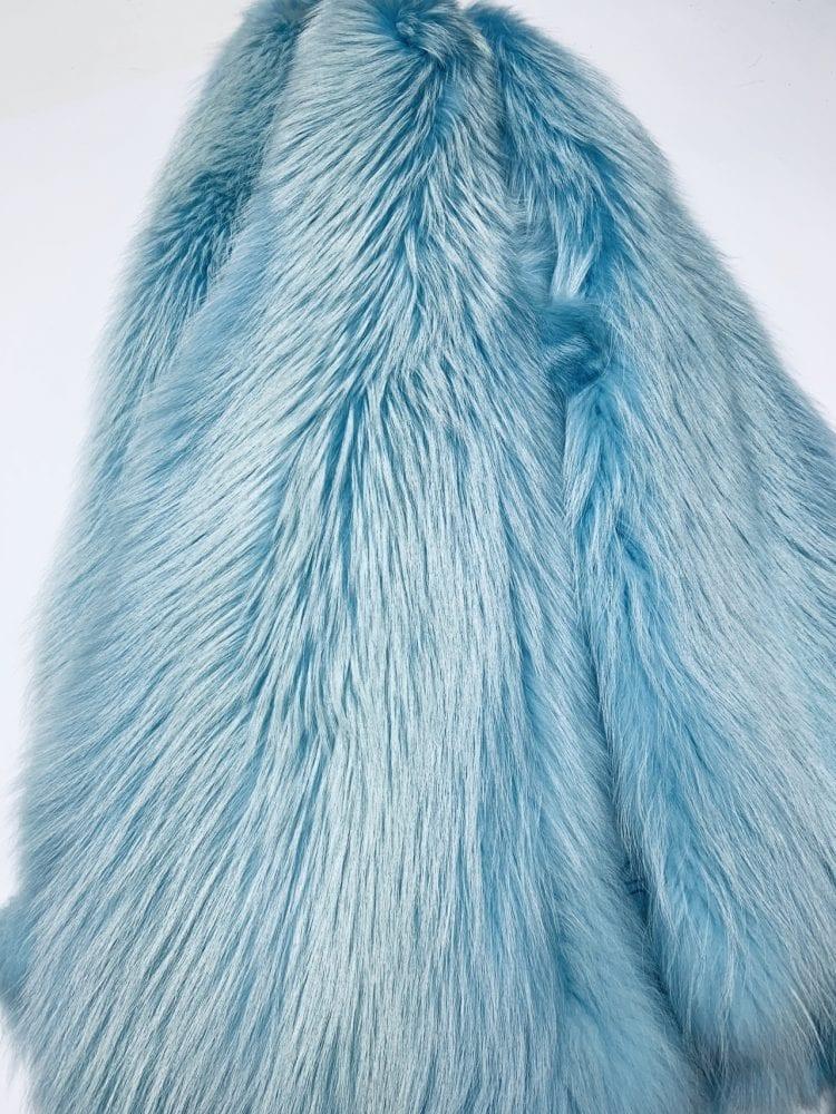 Шкурки енота светло голубые